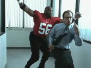 Terry Tate, office linebacker, chasing a coworker